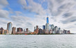 View of New York City with cloudy sky.