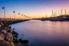Breakwater And Boats At The Harbor At Sunset, In Santa Barbara,