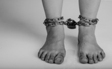 Woman Feet Was Tied By Chain Isolate On White Background