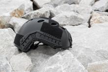 Special Force Modern Combat Helmet On Rock Ground.