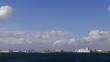 Blue sky timelapse over Tokyo's industrial waterfront