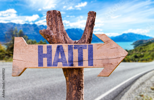Tablou Canvas Haiti wooden sign with road background