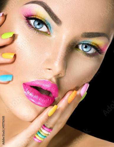 Beauty girl face with vivid makeup and colorful nail polish - 81716368