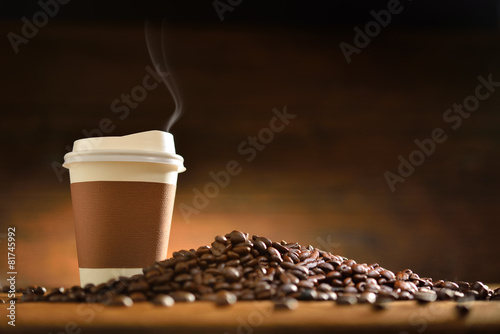 Wall Murals Cafe Paper cup of coffee and coffee beans on old wooden background
