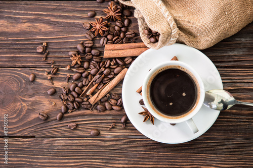 Photo Stands Cafe Cup with coffee on wood background