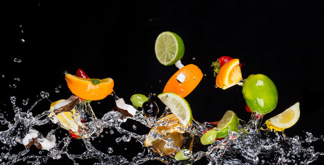 Panel Szklany Mix of fruits with water splashes on black