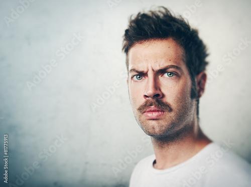 Valokuvatapetti Portrait of a man with a mustache