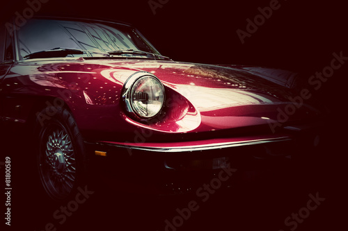 Retro classic car on dark background. Vintage, elegant Canvas Print