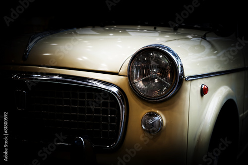 Photo  Retro classic car on black background. Vintage, elegant