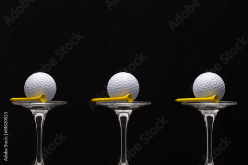 Poster Golf Three glasses of champagne and golf balls