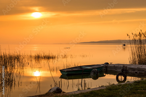 Photo  The boat docked on the lake Balaton