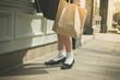 Woman in skirt walking the street