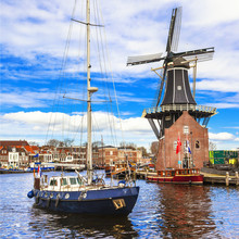 Holland, Haarlem' Canals. Windmill And Sail Boat