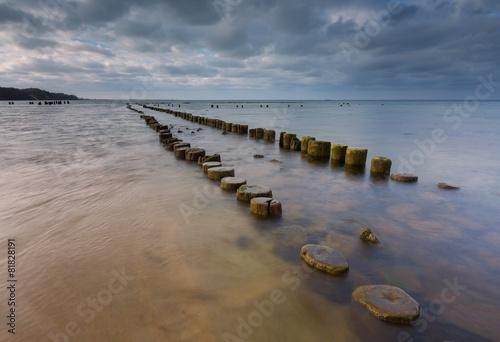Foto auf Gartenposter Nordlicht Sandy shore of Baltic sea and torpedownia near Gdynia.