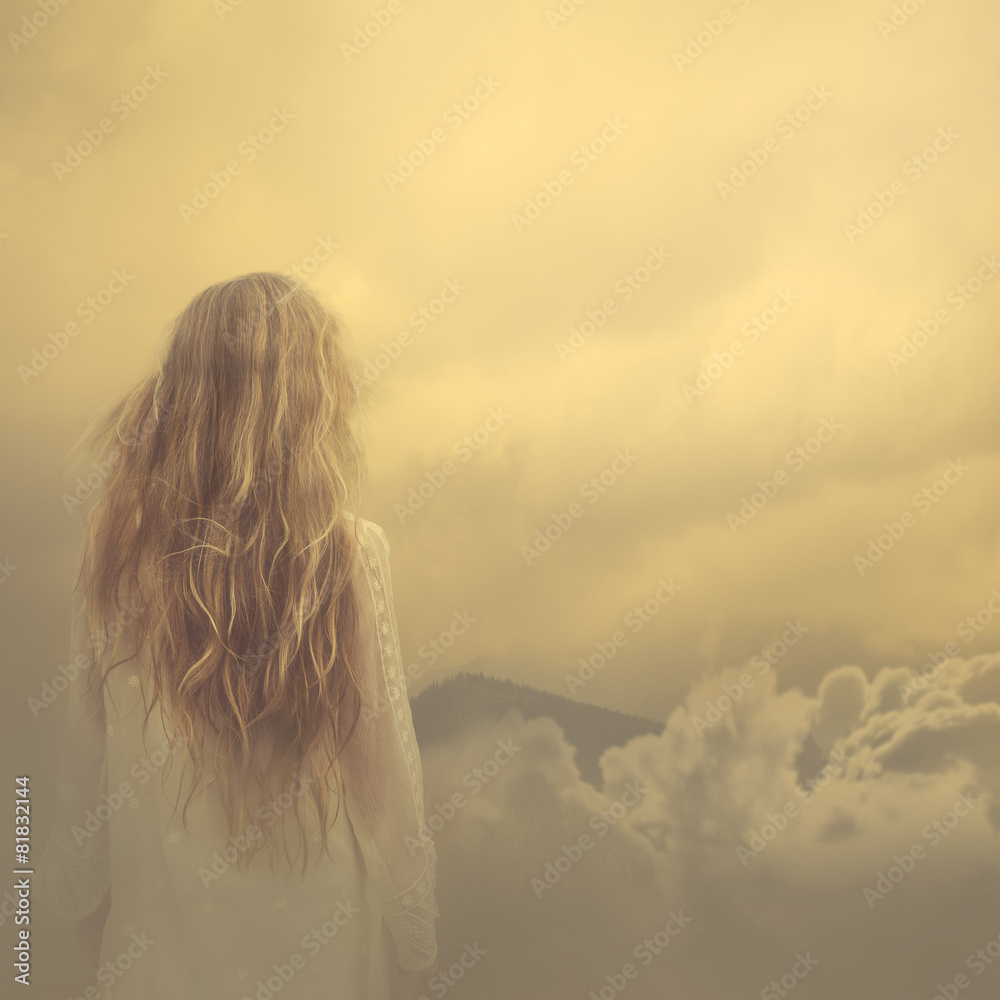 Fototapety, obrazy: girl in a dress stands in the clouds over the mountains
