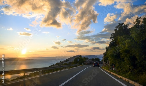 Fotografie, Obraz  Beautiful coastal road at sunset