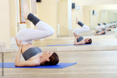 Fotografering  girl doing yoga exercises in the gym
