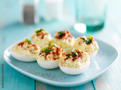 deviled eggs with paprika and green onion garnish