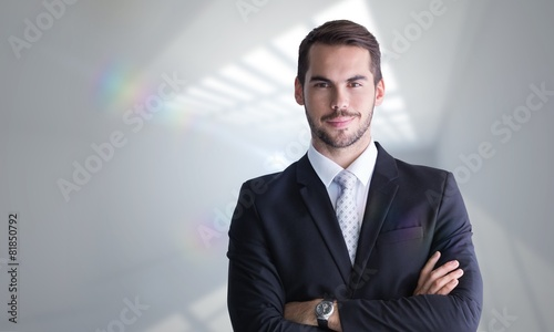 Fototapety, obrazy: Composite image of smiling businessman posing with arms crossed