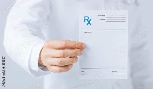 male doctor holding rx paper in hand Canvas Print
