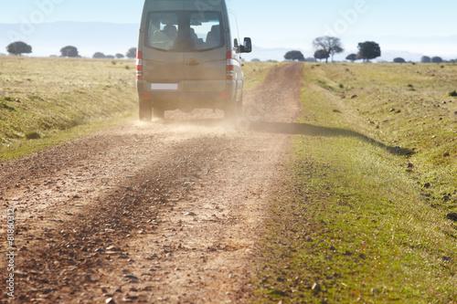 Fotografie, Obraz  Dirty road in a mediterranean meadow with minibus. Cabeneros. Sp