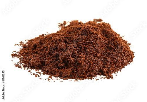 фотография  Pile of ground coffee isolated on white