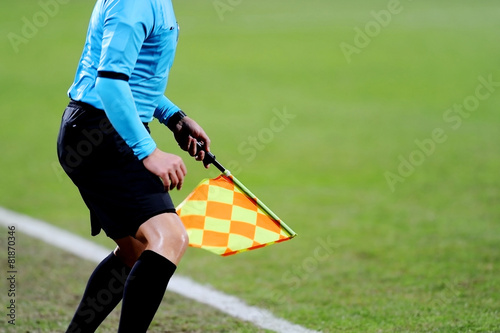 Fotografering  Assistant referee signaling with the flag