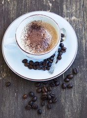 Fototapeta Cappuccino Cup of Coffee with Coffee Beans