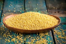 Organic Millet Seeds In A Wooden Bowl