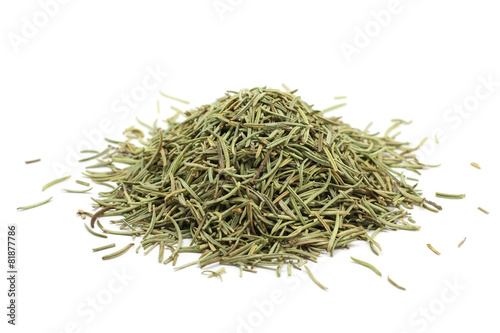 a handful of dried stems of rosemary on a white background