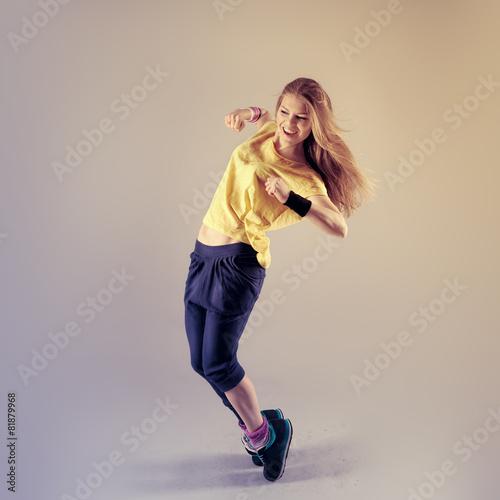 Fényképezés  Young pretty Caucasian hip hop girl dancing with fun