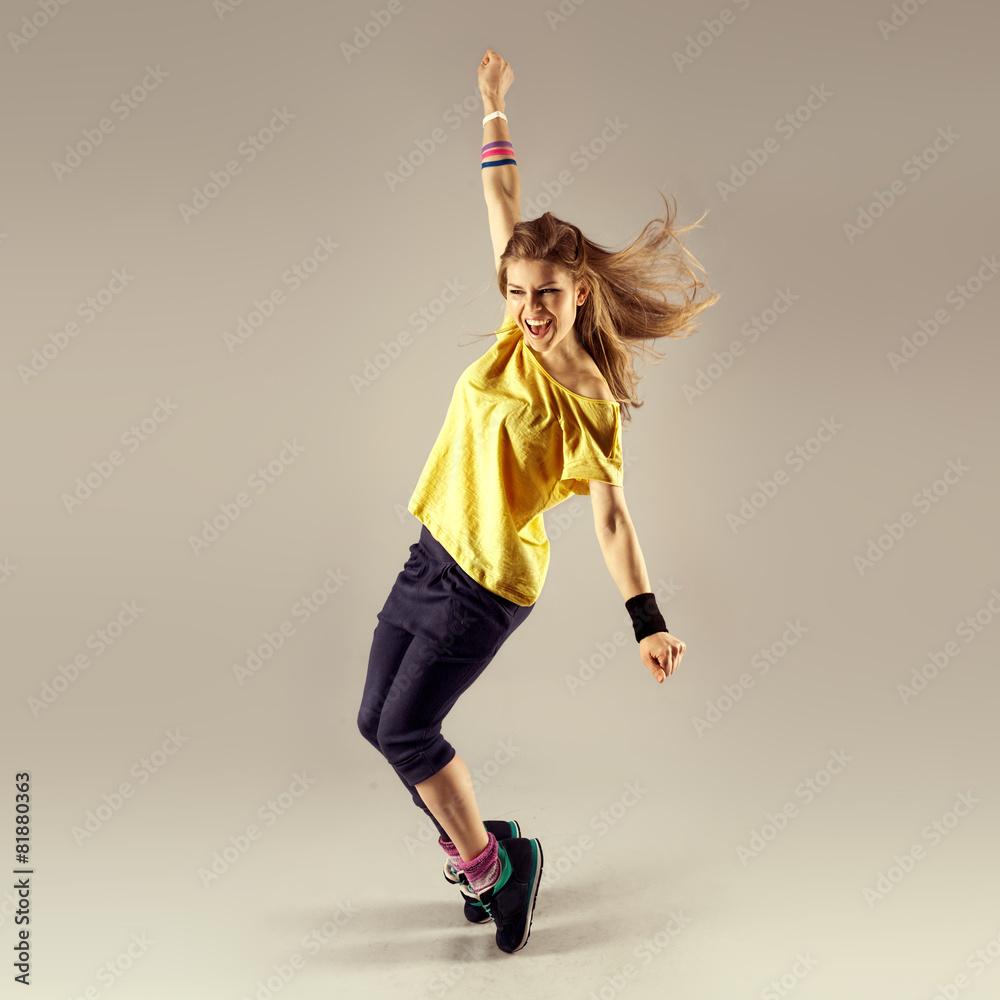 Fényképezés  Zumba dance workout. Young sporty woman dancer in motion.