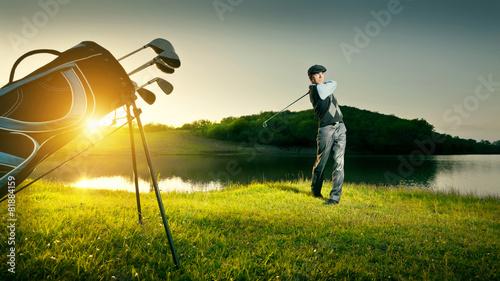 Poster Golf Golf. Golfer makes a strong kick of the ball.