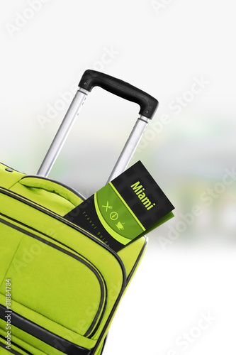 Miami. Green suitcase with guidebook. Slika na platnu