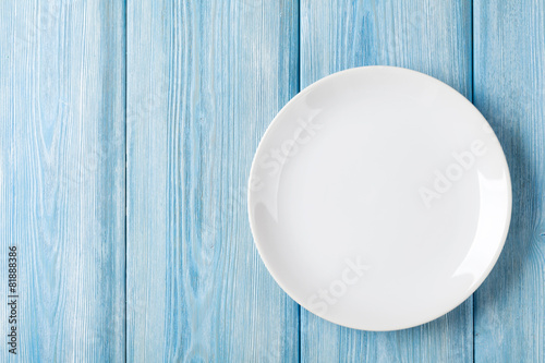 Fotografie, Obraz  Empty plate on blue wooden background