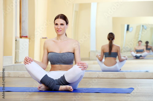 Valokuva  girl doing yoga exercises in the gym