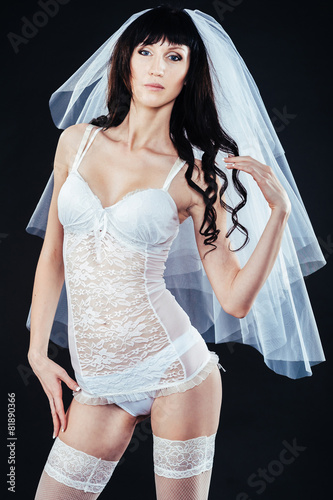 Fotografie, Obraz  Sexy beautiful nude bride with veil in white erotic lingerie on