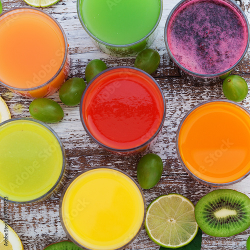 Garden Poster Juice Glasses of tasty fresh juice, on wooden desk.
