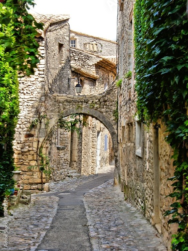 Beautiful arched cobblestone street, Provence, France