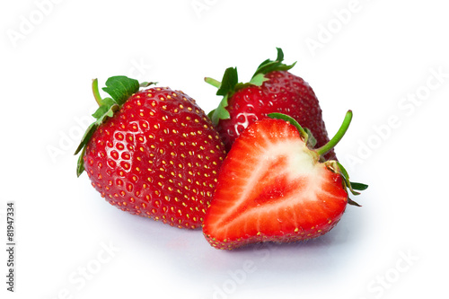 Ripe strawberries on white background