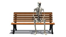 Skeleton Sitting On Park Bench...