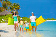 Happy beautiful family on white beach with inflatable air