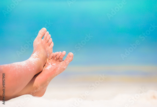 Close up of female feet on white sandy beach Canvas Print