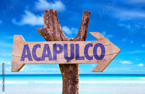 Fototapeta Acapulco wooden sign with beach background