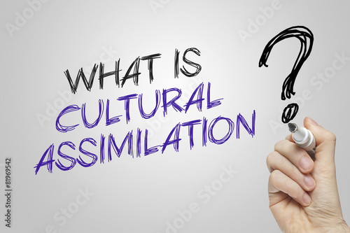 Hand writing what is cultural assimilation Canvas Print