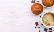 Coffee Cup With A Muffin . Background.