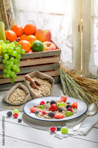 Aluminium Prints Assortment Healthy oat flakes with berry fruits for breakfast