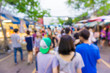 Blur of tourists are walking and shopping in Chatuchak market