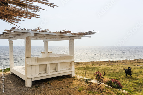 Printed kitchen splashbacks Lounge aus Holz am Meeresstrand