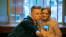 Couple Doing Selfie In The Caf...